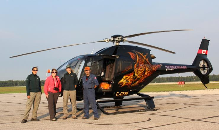 Eurocopter EC120 Colibri used during Wood Buffalo Whooping Crane survey. L-R: Queenie Gray, Amy Lusk, Sharon Irwin and pilot Mark Rayner.